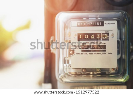 Electric power meter measuring power usage. Watt hour electric meter measurement tool at pole, outdoor electricity for use in home appliance monitor the home's electrical energy consumption. #1512977522
