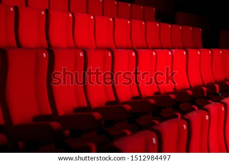Rows of red theater or cinema  seats #1512984497