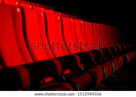 Rows of red theater seats #1512984506