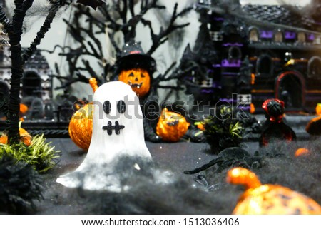 White spooky ghost doll, pumpkin wizard, spider and many pumpkin head decoration in dark night scenery with branches leaves and creepy castle DIY handmade for 31st October, Halloween event party day
