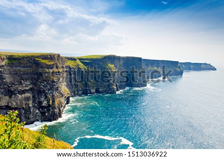Spectacular Cliffs of Moher are sea cliffs located at the southwestern edge of the Burren region in County Clare, Ireland. Wild Atlantic way Royalty-Free Stock Photo #1513036922