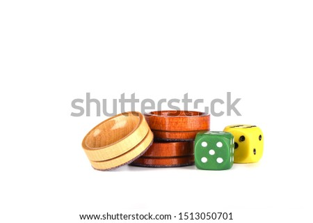 Colorful dice and wooden backgammon checkers isolated on a white background. Copy space. #1513050701