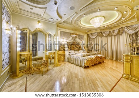 luxurious  interior. Designer modern renovation in a luxury house. Stylish bedroom interior with double bed