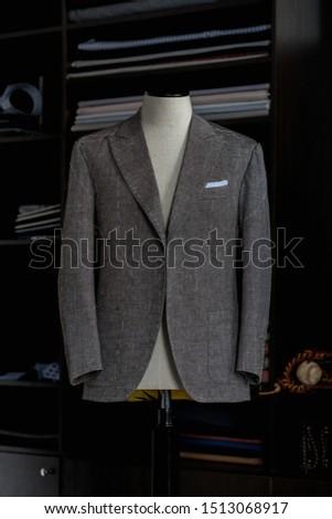Stylish bespoke grey jacket. Men's jacket on a mannequin. Men's Clothing #1513068917