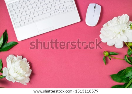 Fashionable feminine workspace flat lay. Female home office with laptop, coffee cup and peony flowers on pink background. Femininity background. Freelance, home work concept. Top view #1513118579