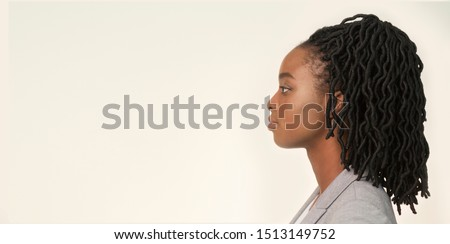 Profile Portrait Of Serious Black Businesswoman Posing Over White Background. Studio Shot, Panorama, Copy Space #1513149752
