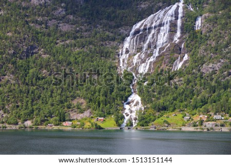 Norway fiord landscape - part of Hardanger Fjord called Sorfjord. Waterfall falling into the fiord. #1513151144