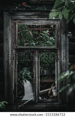 broken window in an abandoned building #1513186712