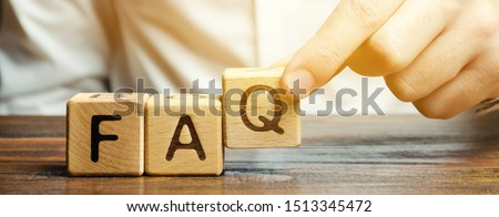 Businessman puts wooden blocks with the word FAQ (frequently asked questions). Collection of frequently asked questions on any topic and answers to them. Instructions and rules on Internet sites #1513345472
