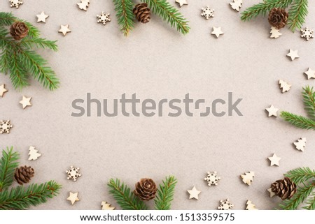 Christmas card light background with wooden decor fir tree branches border frame with copy space #1513359575