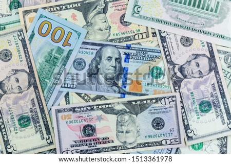 Money american hundred dollar bills Pile of various currencies isolated on white background.Closeup of assorted American banknotes.US currency scattered on the table.america currency dollor currency. #1513361978