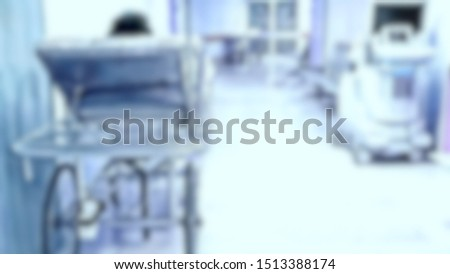 Blurred image of unidentified  patient on bed waiting in hallway. Close up patient on stretcher in hospital, focus blur, Out-of-focus, Focus blur #1513388174