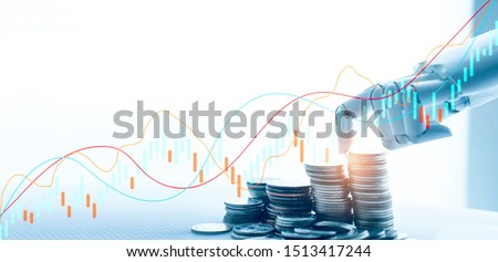 AI(Artificial Intelligence) and Financial Technology concept.Robot Hand Stacking pile of Coins,Financial technology, Stock chart,Investment,Fintech on white background.
