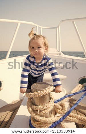 funny kid in striped marine shirt. small sailor on boat. summer vacation. childhood happiness. Transportation. happy small boy on yacht journey. Sea journey. journey concept. #1513533914