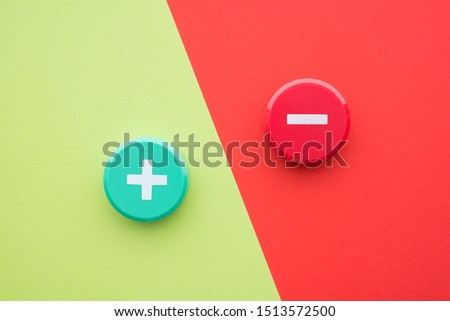 Flat lay of green plus and red minus symbol plastic botton on green and red background with copy space. Concept of difference, opposites plus vs minus or pros vs cons. #1513572500