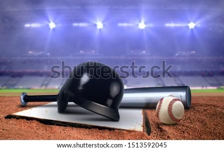 Baseball equipment in a stadium under spotlights #1513592045