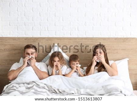 Family ill with flu in bed at home Royalty-Free Stock Photo #1513613807