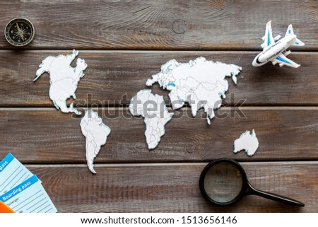 Planning a travel concept. Sketchy map of the world on dark wooden background top view #1513656146