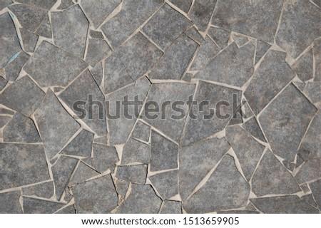 texture of grey tiles of irregular geometric shape #1513659905