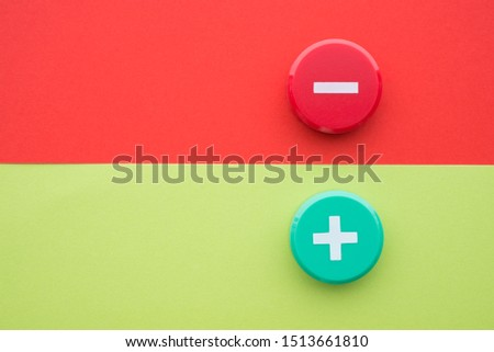 Flat lay of green plus and red minus symbol plastic botton on green and red background with copy space. Concept of difference, opposites plus vs minus or pros vs cons. #1513661810