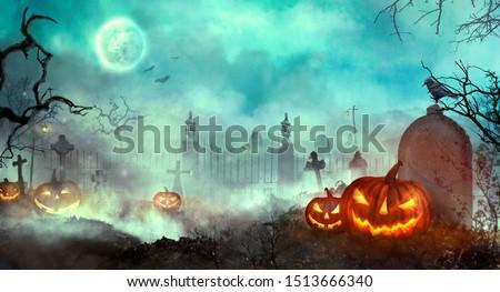 Halloween pumpkins on the graveyard. Halloween design with Jack O' Lantern 3D illustration  #1513666340
