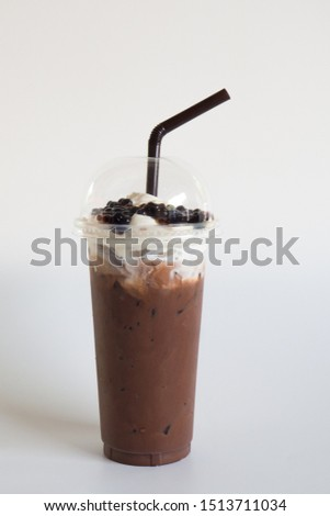 Iced cocoa in takeaway cup, whip cream and pearl isolated on white background, macro. #1513711034