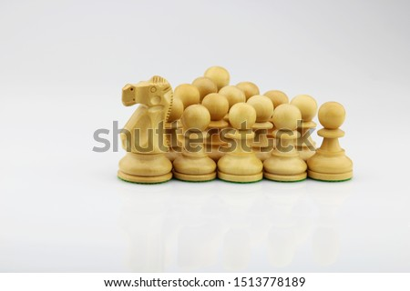 Chess pawn formation with a knight leading the group that illustrate leadership, unity and teamwork concept #1513778189
