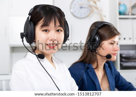 Sales assistants working with computers in an office #1513812707