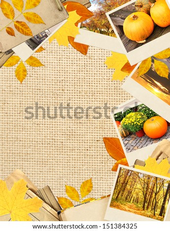 Frame with autumn leaves and photos. Objects over canvas texture