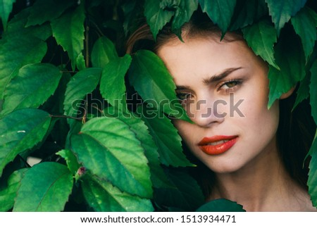 Beautiful woman green leaves red lips tropics garden model #1513934471