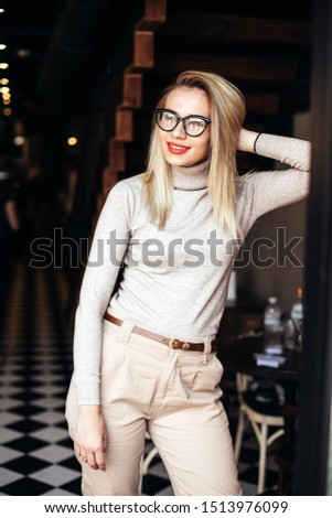 Outdoor photo of sensual lady whith red lips posing on architecture background in autumn day. Close up fashion street stile portrait.wearing cute trendy outfit.