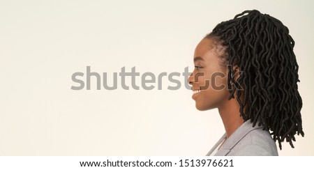 Portrait Of Smiling African American Businesswoman Looking Aside On White Background In Studio. Side View, Panorama, Empty Space #1513976621