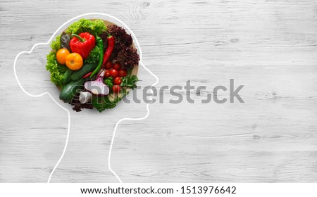 Health in your brain. Fresh vegetables in woman head symbolizing health nutrition on gray background, panorama, copy space #1513976642