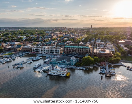 Aerial shot of Old Town Alexandria with a steamboat on the river at sunset #1514009750