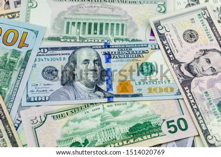 Money american hundred dollar bills Pile of various currencies isolated on white background.Closeup of assorted American banknotes.US currency scattered on the table.america currency dollor currency. #1514020769