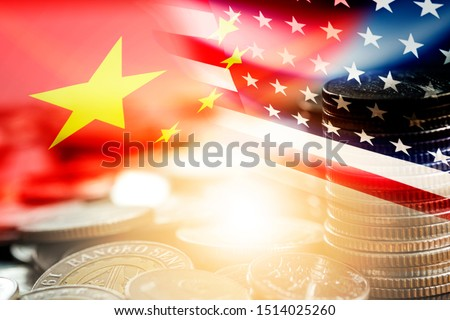 USA and China flag on coins stacking .It is symbol of economic tariffs trade war and tax barrier between United States of America and China. #1514025260