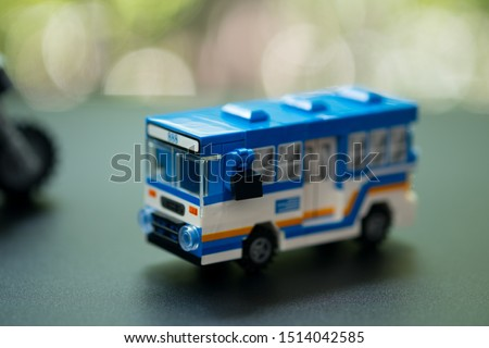 Miniature toy bus. People travel by bus in Bangkok. Buses are one of the most important public transport system in Bangkok. #1514042585