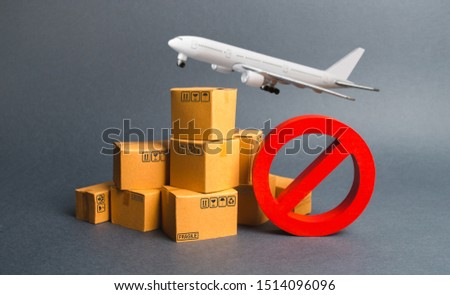 Cargo plane, many boxes and red prohibition symbol NO. Embargo trade wars. Restriction on importation, ban transit export dual-use goods to countries under sanctions. transport companies. #1514096096