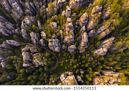 Adrspach rocks at sunset. Aerial top down view of trail path in rock formations, cliffs and trees of Adrspach Teplice rocks national park. Adrspach, Bohemia, Czech Republic, Czech mountains landscape. #1514250113