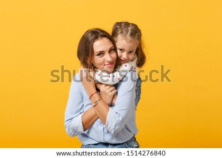 Woman in light clothes have fun with cute child baby girl 4-5 years old. Mommy little kid daughter isolated on yellow background studio portrait. Mother's Day love family parenthood childhood concept #1514276840