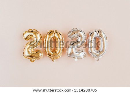 Foil balloons in the form of numbers 2020. New year celebration. Gold and silver Air Balloons. Holiday party decoration.  #1514288705