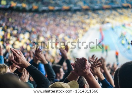 Football- soccer fans support their team and celebrate goal in full stadium with open air. Royalty-Free Stock Photo #1514311568
