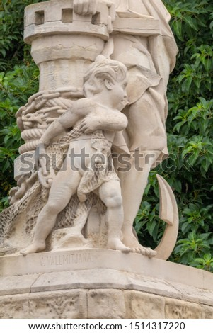 On the streets in Spain in public places. Plaster or marble sculptures and statues, decoration of urban architecture. #1514317220