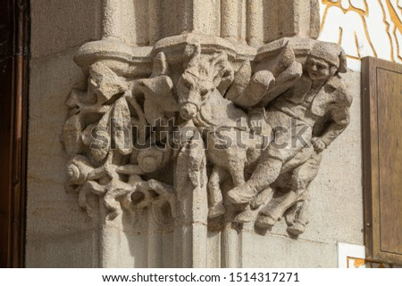 On the streets in Spain in public places. Plaster or marble sculptures and statues, decoration of urban architecture. #1514317271