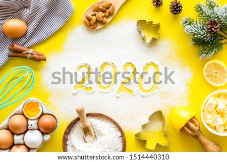 Happy New Year concept. 2020 written on yellow baking background top view #1514440310