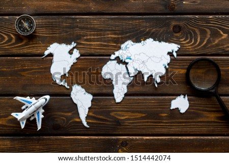 Planning a travel concept. Sketchy map of the world on dark wooden background top view #1514442074