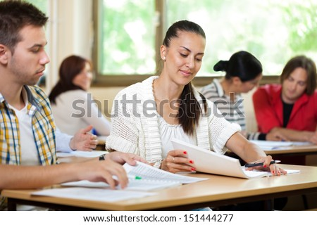 Young students in classroom studying together #151444277