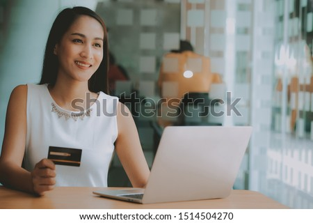 woman using computer & credit card for online payment shopping #1514504270
