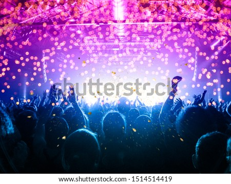 Concert blurred lights in a large crowded venue Royalty-Free Stock Photo #1514514419