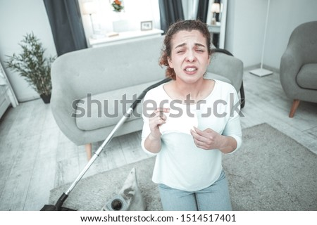 House moss. Curly red-haired woman sneezing and coughing having allergy to house moss #1514517401